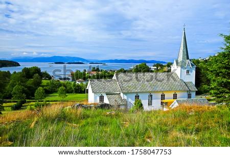 Rural country church view. Mountain lake village church landscape. Rural church view