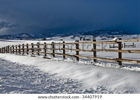 Rural country wooden fence in Colorado in the winter