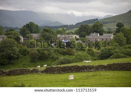 rural countryside farm land and village in Cumbria, lake district - stock photo