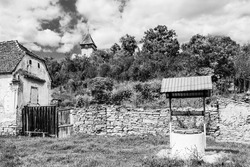 Rural countryside landscape of Rodbav village, the medieval evangelical saxon fortified church near Fagaras, Brasov county, Transylvania, Romania; Traditional saxon fortified church of Transylvania