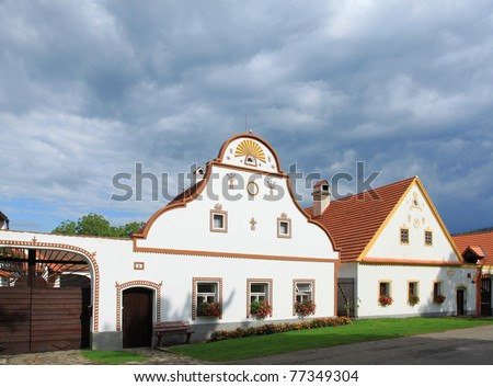 Rural decorated houses in Holasovice, Czech Republic. UNESCO World Heritage Site in South Bohemia.