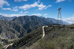 Rural electric power pylon towers along Mt Lukens Truck Trail fire road in the San Gabriel Mountains in Los Angeles County California.