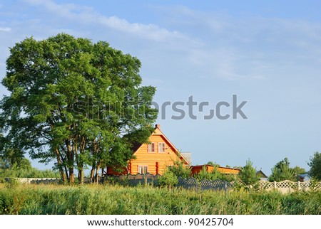 Rural farm house with tree on sky background.