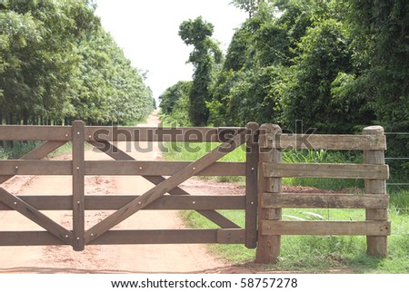 Rural gate of wood on brazilian farm, northwest of Parana State.