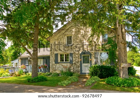 Rural house with leafy trees