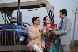 Rural Indian couple using digital payment