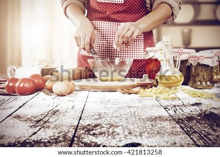 rural kitchen interior and woman making cake