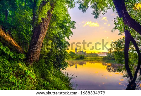 Rural lake water in sunrise morning. Lake water sunrise landscape. Sunrise forest lake view. Forest lake in sunrise