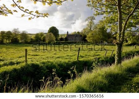 Rural landscape and church, Milborne Port, Sherborne, Dorset, UK