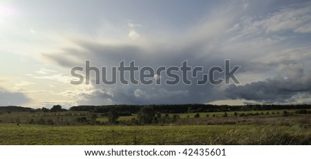 Rural landscape and cloudscape. Autumn evening. In expectation of a thunder-storm