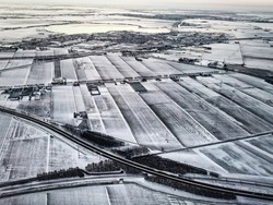 Rural landscape, Farmfield covered in snow, The Netherlands from above.