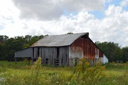 Rural landscape photo of an old barn on a farm in the country