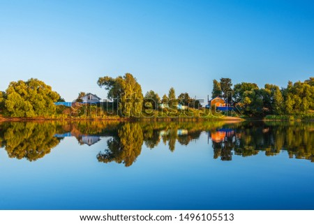 Rural landscape with rural houses, river at sunset #1496105513