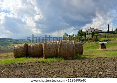 Rural landscape with stack of hay. Tuscan, Italy
