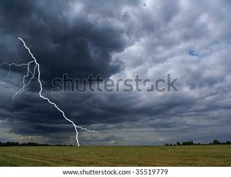 Rural landscape with thunderstorm