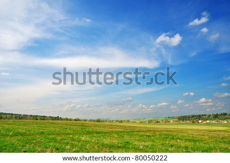 Rural landscape with wonderful cloudy sky and green grass