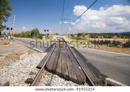 rural level crossing next to segovia city in spain