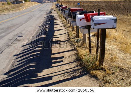 Rural mailboxes lined up at a mountain location