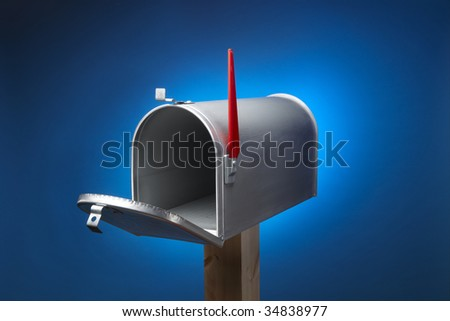 Rural metal mail box opened and sitting on wood post