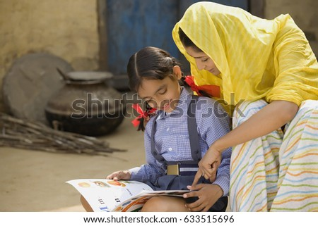 Rural mother reading with her daughter