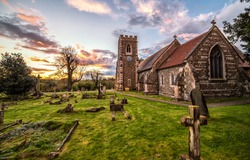Rural old cemetery church in evening. Cemetery church in rural sunset. Sunset cemetery church. Old cemetery church scene