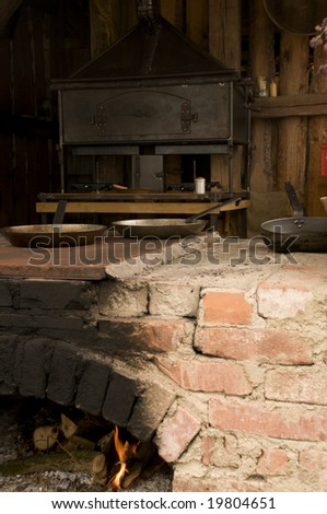 Rural outdoor kitchen with pots and pans