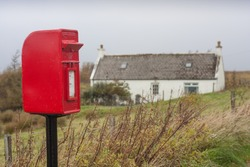 rural red letterbox in scotland