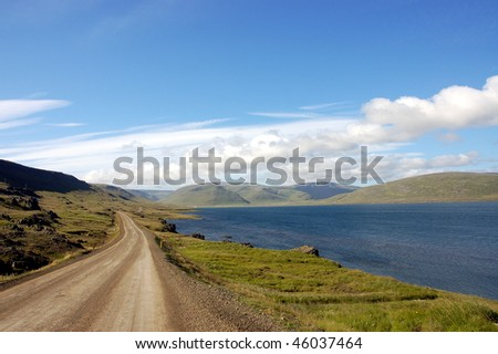 Rural road along the fjord, Iceland.