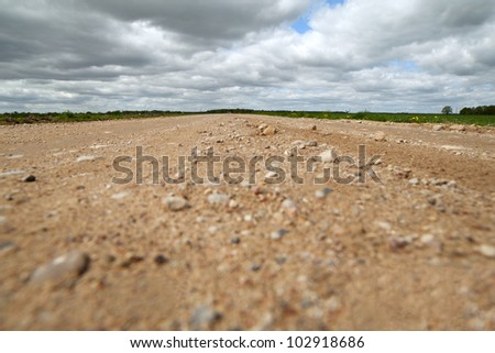 Rural road and cloudy sky.