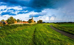 Rural road in windy day. Windy village pathway. Windy weather village scene. Windy village landscape