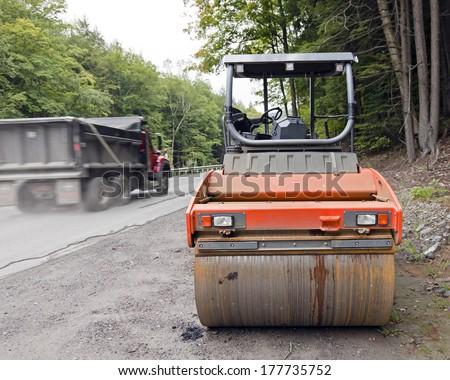 Rural road repair with steam rollers.