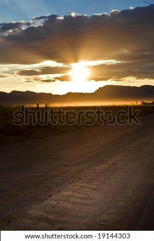 Rural Road Sunset - stock photo