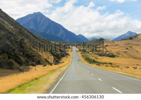 Rural Scene of Asphalt Road with Meadow and Mountain Range, South Island, New Zealand - Shutterstock ID 456306130