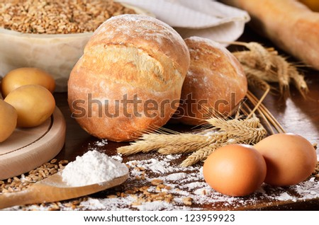 Rural scene of homemade bread with potatoes and eggs. Landscape view.