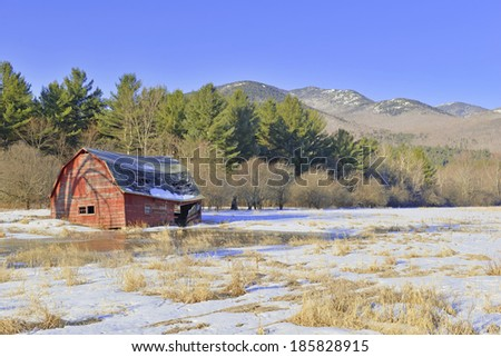 Rural Scene with Old Barn and field in the mountains Stock fotó ©