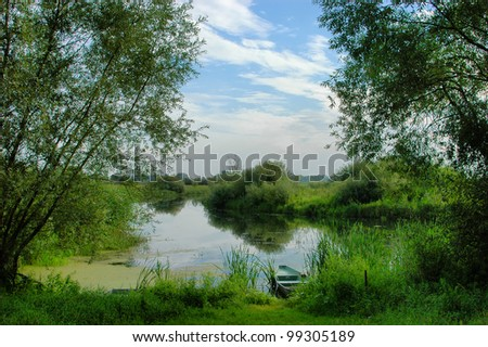 rural scenery with river and boat in Central Europe