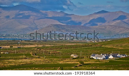 Rural Spring Irish Landscape: Typical mountain and houses landscape from the west coast of Ireland in County on dingle peninsula or ring of kerry.Popular destination for tourism and holiday homes
