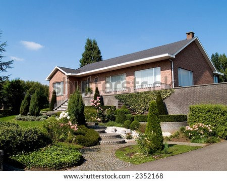 Rural suburban house  with garden in belgium. Summer period, sunny day. Real estate concept.
