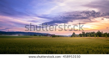 Rural Sunset Landscape of Swiss Farmland With Tractor And Farm-House In Background #458953150