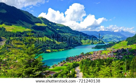 Rural Swiss Scenery from Train Ride Window View, Picturesque Lungern Village and Lake Picture as a Painting in beautiful summer, Lungern, Switzerland, Europe. Travel Swiss Nature, Tourist Attraction.