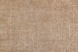 Rural texture of sackcloth. Background of very coarse, rough fabric woven made of flax, jute or hemp. Burlap bag material. Design element. Sacking and bagging  pattern. Top view.