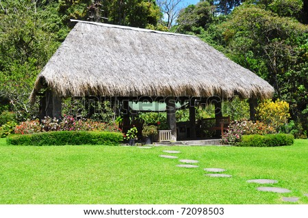 Rural tropical hut in the backyard of a house