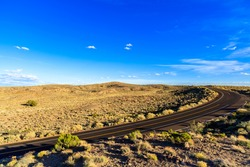 Rural two lane highway in the Arizona desert.