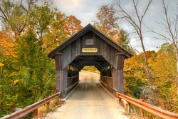 Rural Vermont Covered Bridge by the name of Gold Brook in Stowe, Vermont, USA