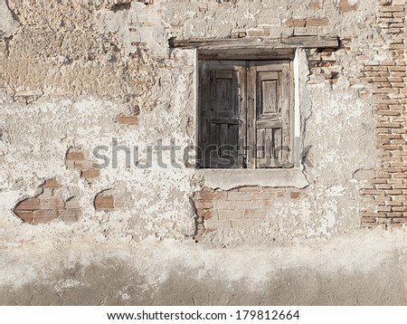 Rural window, spanish architecture, bricks wall and wooden details
