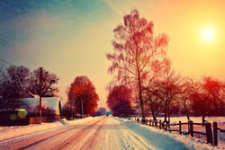 Rural winter landscape. Country road covered with snow