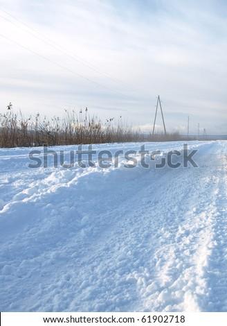 Rural winter road - stock photo