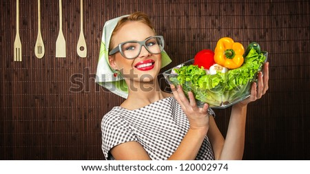 Rural woman cook holding bowl with vegetable, close-up