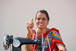 Rural woman Worker Tailor showing Thumbs Up