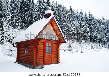 rural wooden building on mountain top at ski resort. vintage picture. winter wallpaper